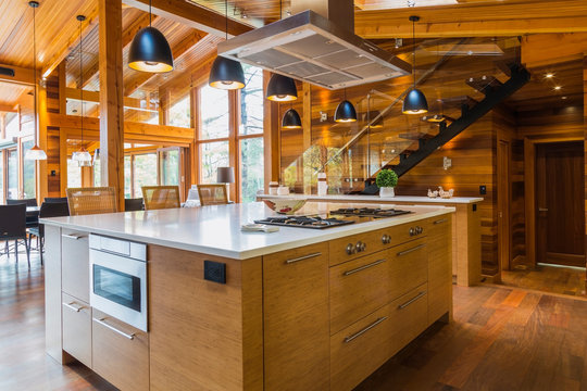 Bamboo wood kitchen island with white quartz countertops, luxurious cedar wood home