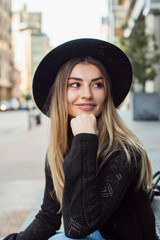 Portrait of woman wearing hat, hand on chin looking away, New York, USA