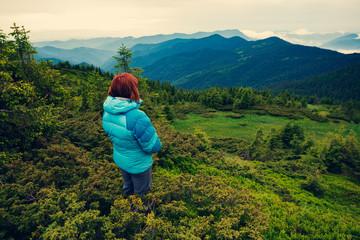 Adventurer female on the mountain slope
