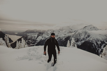 Man in deep snow on mountain, Abbotsford, Canada
