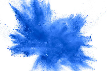 Abstract blue dust explosion on white background.  Freeze motion of blue powder splash. Painted Holi in festival. Fototapete