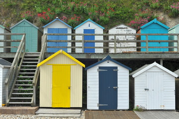 Beach huts on an English beach in Beer, Devon