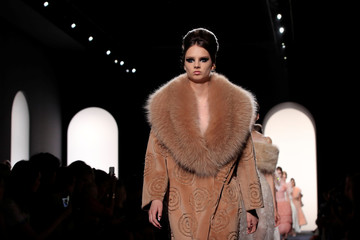 Models present creations by designers Karl Lagerfeld and Silvia Venturini as part of their Haute Couture Fall/Winter 2018/2019 collection show for fashion house Fendi in Paris