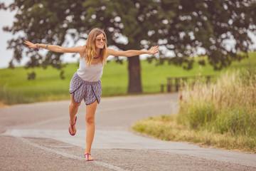 Girl enjoying on a empty suburb road.