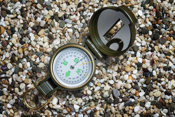 Compass on the sand.