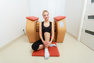 Woman relaxing after cellulite treatment on machine