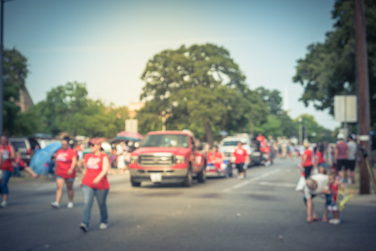 Vintage blurred traditional July 4th parade in Irving, Texas, USA