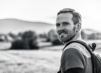 Portrait of a man in a hike in monochrome tones.