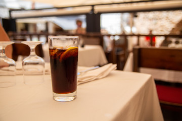 Glass of cold drink in street cafe.