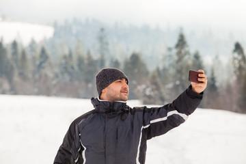 Selfie against the backdrop of winter landscape