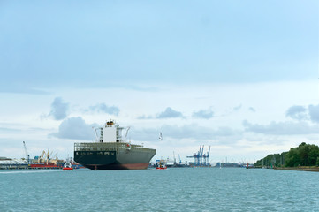 blue cargo ship on water, huge empty container ship