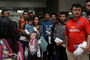 Undocumented immigrant families are released from detention at a bus depot in McAllen