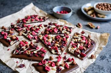 Chocolate bark with hazelnuts, peanuts, cranberries and freeze dried raspberries