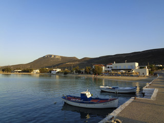 a small bay with ships in greece