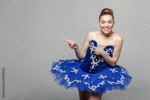 fbf0793c503d Portrait of toothy smiley beautiful ballerina woman in blue costume ...
