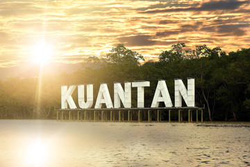 Kuantan sign on river in Kuatan, Phahang, Malaysia - River water with reflection while sunset