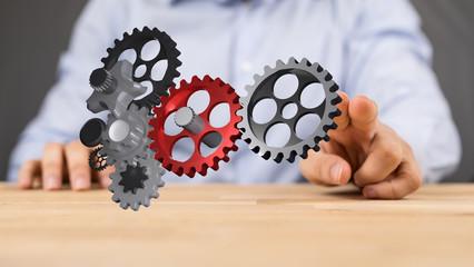 cogwheel in hand