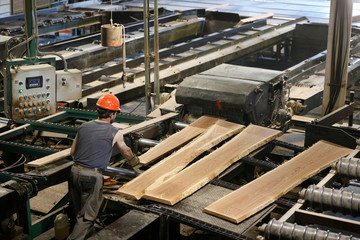 A worker processes lumber in the sawmill at the Murray Brothers Lumber Company in Madawaska