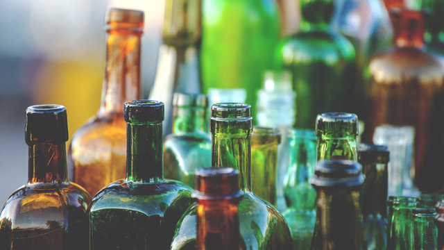 collection of old glass bottles, toned