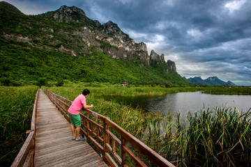 The wooden bridge overlooking the scenery at Sam Roi Yod National Park. It is beautiful and surrounded by nature in Prachuap Khiri Khan, Thailand.