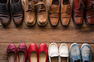 shoes with men and women various styles on a wooden floor - lifestyles.