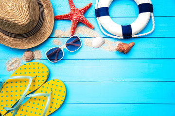 Accessories with woman for travel summer. On blue wooden floor