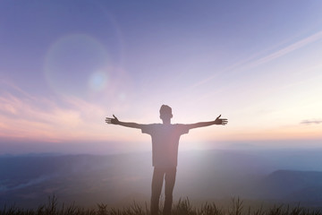 Happy man rise hand on morning view. Christian inspire praise God on good friday background. Now one man self confidence on peak open arms enjoying nature the sun concept world wisdom fun hope.