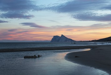 View of The Rock of Gibraltar and La Linea de la Concepcion as seen from the Mediterranean coast at sunset, Cadiz, Andalusia, Spain, Europe