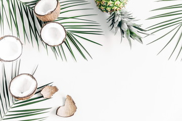 Summer background. Tropical palm leaves, coconut on a white background. Summer concept. Flat lay, top view, copy space
