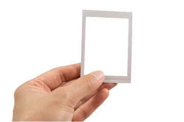 Hand holding instant photo or picture frame isolated on white background with clipping path.