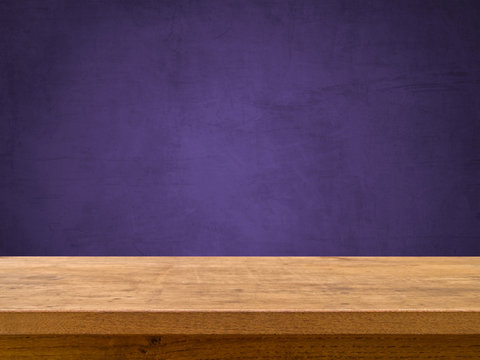 Wooden table on purple ultra violet chalkboard for background, color of the year 2018