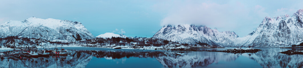 Landscape with beautiful winter lake and snowy mountains at Lofoten Islands in Northern Norway. Panoramic view