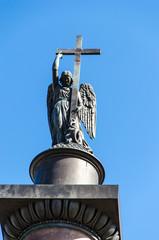 Angel on the Alexander Column against a against the blue sky . St. Petersburg