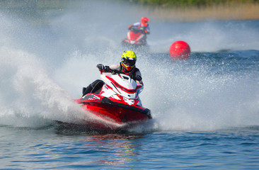 Foto op Canvas Water Motor sporten Jet Ski Racers Moving at Speed Creating a lot of Spray