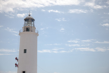 Lighthouse and some workers climbing through it to do masonry and painting work