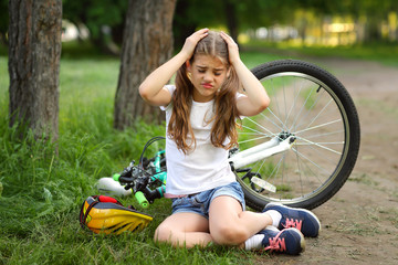 The girl was injured while riding a bike in the summer.