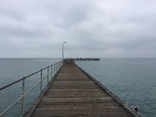 Pier to horizon on overcast day
