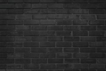 Black brick wall texture background. Brickwork or stonework flooring interior rock old pattern clean concrete grid uneven bricks design stack.