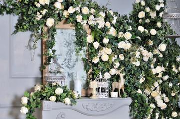 Elegant white fireplace full of flowers