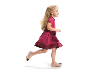 Smiling cute toddler girl three years running over white background