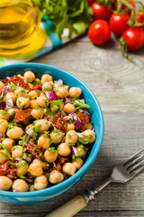 Chickpeas salad with onion and dried tomatoes.