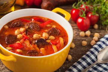 Traditional chickpea soup with paprika and chorizo sausage.