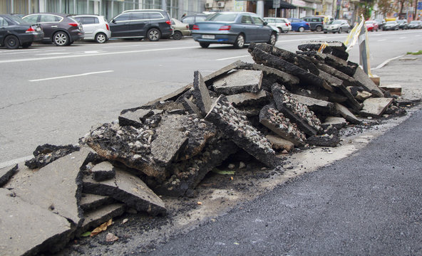 Pile of asphalt on the side of the road during repairs