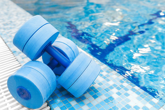 dumbbells equipment for aqua aerobics sport near swimming pool