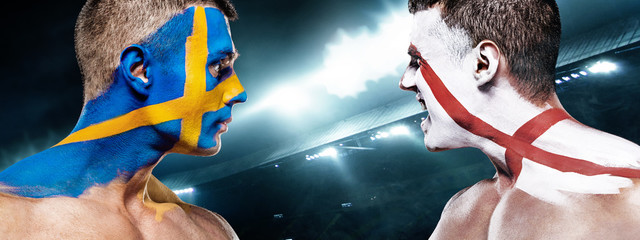Soccer or football fan with bodyart on face on stadium - flags of Sverige, Sweden vs England. Sport Concept with copyspace.