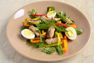 Fish salad with quail eggs, sweet peppers and fresh herbs