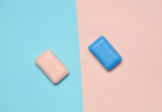 Pieces of soap on a blue pink pastel background. Top view, minimalist trend.
