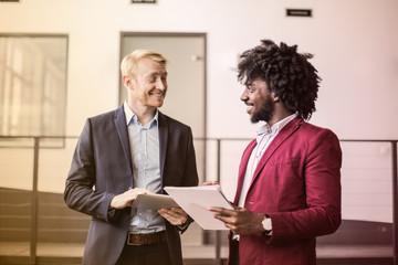 Businessmen talking in the office