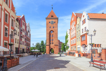 Elblag ( Elbląg) in polish Pomerania - Stary Rynek Street is center of Old Town, with rebuilt tenement houses. Street is closed at end of medieval  Market Gate (Brama Targowa)
