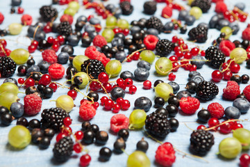 Various fresh summer berries. Top view. Berries mix fruit color food dessert.Berries.Antioxidants, detox diet, organic fruits.